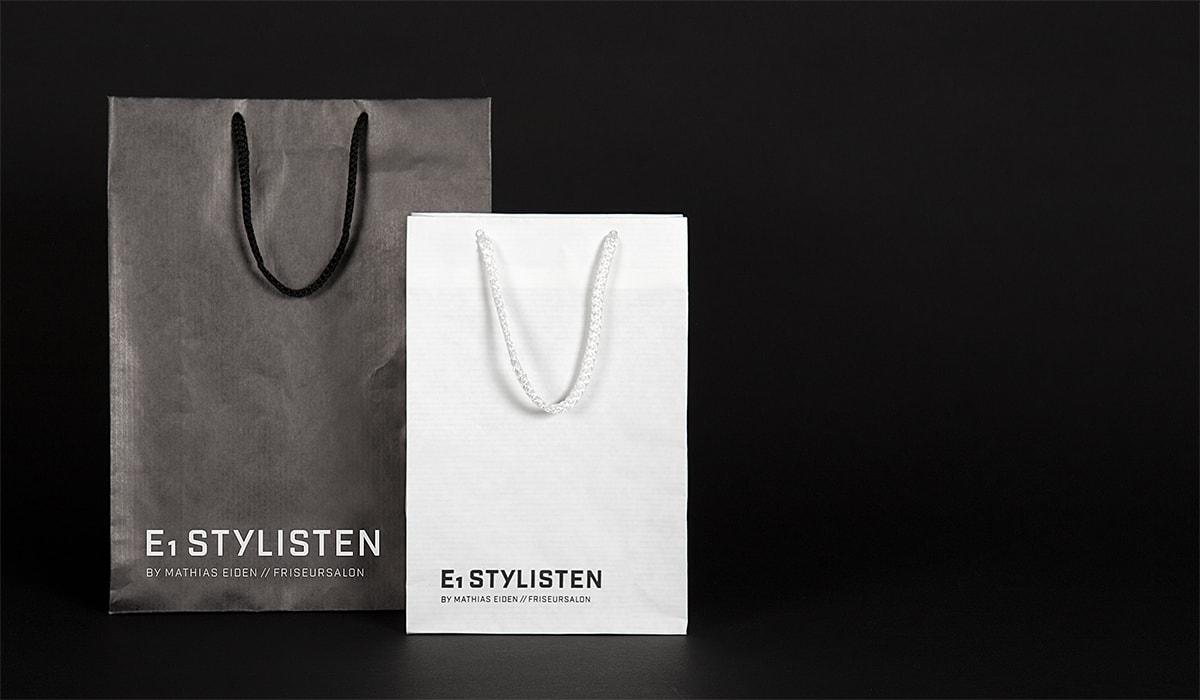 Konzeptarbeit ~ Corporate Design ~ Tragetaschen // Tragetaschen mit Logoprint in Schwarz und Weiß // E1 Stylisten